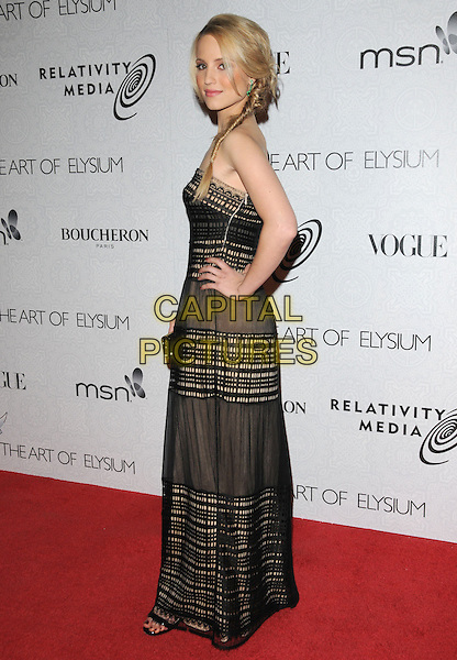 "DIANNA AGRON.Art of Elysium 3rd Annual Black Tie charity gala '""Heaven"" held at 990 Wilshire Blvd in Beverly Hills, California, USA, .January 16th 2010 .full length maxi dress strapless black hand on hip striped stripes print cream pattern side.CAP/RKE/DVS .©DVS/RockinExposures/Capital Pictures"