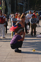 Street performers along the Ramblas walking street in Barcelona, Spain.