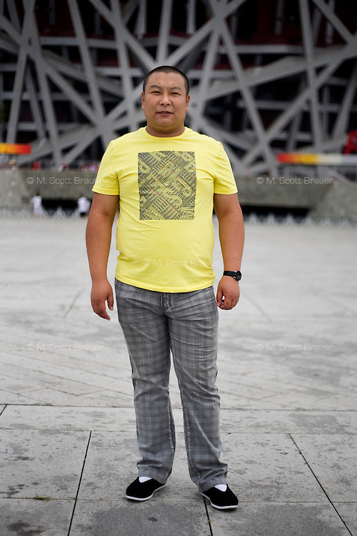 Huojichao, a designer, age 29, poses for a portrait in Beijing. Response to 'What does China mean to you?': 'My mother. My beloved home.'  Response to 'What is your role in China's future?': 'To create.'