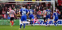 Chesterfield's Kristian Dennis scores his sides first goal from the penalty spot, sending Lincoln City's Josh Vickers the wrong way<br /> <br /> Photographer Chris Vaughan/CameraSport<br /> <br /> The EFL Sky Bet League Two - Lincoln City v Chesterfield - Saturday 7th October 2017 - Sincil Bank - Lincoln<br /> <br /> World Copyright &copy; 2017 CameraSport. All rights reserved. 43 Linden Ave. Countesthorpe. Leicester. England. LE8 5PG - Tel: +44 (0) 116 277 4147 - admin@camerasport.com - www.camerasport.com
