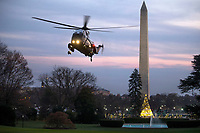 Marine One, with US President Donald J. Trump aboard, lands on the South Lawn of the White House  in Washington DC, USA, 02 December 2017. President Trump was returning from a fundraising trip to New York. Photo Credit: Shawn Thew/CNP/AdMedia