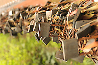 Numerous locks hanged on the sides of stairs in Leshan Giant Buddha Scenic Area, Sichuan Province, China. The Chinese has this belief that each of these locks represents their prayers and wishes and when they put these locks there, those prayers and wishes would be granted. .12 Jul 2010
