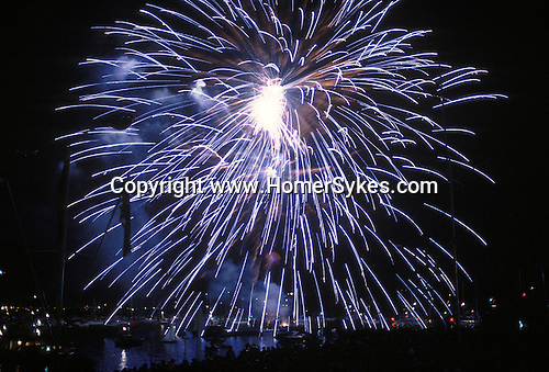 Cowes Regatta Isle of Wight.  Fireworks burst over the Marine Parade to round off the racing.  The English Season published by Pavilon Books 1987