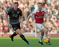 Arsenal's Stephan Lichtsteiner gets away from Burnley's Chris Wood<br /> <br /> Photographer David Shipman/CameraSport<br /> <br /> The Premier League - Arsenal v Burnley - Saturday 22nd December 2018 - The Emirates - London<br /> <br /> World Copyright © 2018 CameraSport. All rights reserved. 43 Linden Ave. Countesthorpe. Leicester. England. LE8 5PG - Tel: +44 (0) 116 277 4147 - admin@camerasport.com - www.camerasport.com