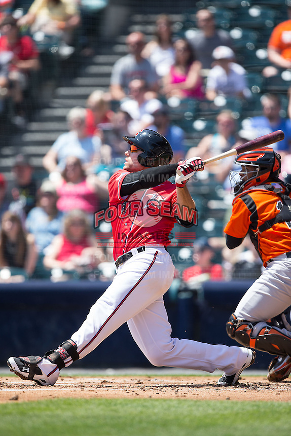Mac Williamson (7) of the Richmond Flying Squirrels follows through on his swing against the Bowie Baysox at The Diamond on May 25, 2015 in Richmond, Virginia.  The Flying Squirrels defeated the Baysox 6-1. (Brian Westerholt/Four Seam Images)