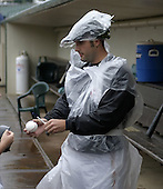 August 30, 2004:  Pitcher Dave Gassner of the Rochester Red Wings, Triple-A International League affiliate of the Minnesota Twins, wears garbage bags as a rain suit before a game at Frontier Field in Rochester, NY.  Photo by:  Mike Janes/Four Seam Images