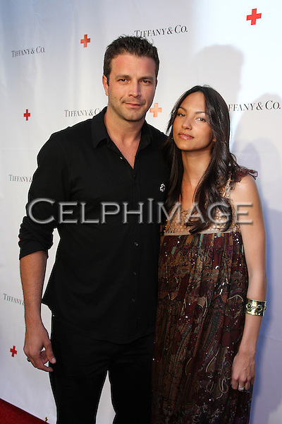 TONY SCHIENA, BIANCA CHRISTIANS. Red Carpet arrivals to An Evening of Legendary Style, honoring the American Red Cross Tiffany Circle Society of Women Leaders, at Tiffany & Co. on Rodeo Drive. Beverly Hills, CA, USA. May 6, 2010.