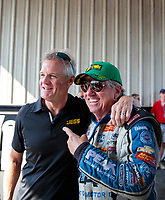 Sep 29, 2019; Madison, IL, USA; NHRA funny car driver John Force (right) with NASCAR driver Kenny Wallace during the Midwest Nationals at World Wide Technology Raceway. Mandatory Credit: Mark J. Rebilas-USA TODAY Sports