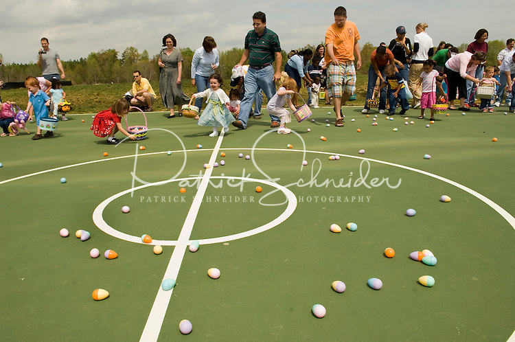 Children participate in an Easter egg hunt during a holiday party at Berewick master-planned community in southwest Mecklenburg County, Charlotte, NC. The property is developed by Pappas Properties.