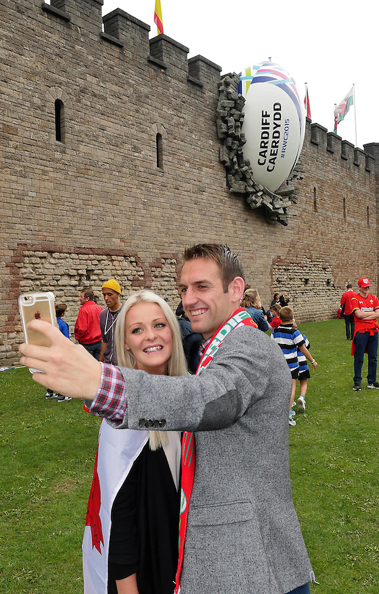 Fans do a selfie in front of Cardiff Castle with the RWC2015 ball in the wall . <br /> <br /> Photographer Ian Cook/CameraSport<br /> <br /> Rugby Union - 2015 Rugby World Cup - Wales v Uruguay - Sunday 20th September 2015 - Millennium Stadium - Cardiff<br /> <br /> &copy; CameraSport - 43 Linden Ave. Countesthorpe. Leicester. England. LE8 5PG - Tel: +44 (0) 116 277 4147 - admin@camerasport.com - www.camerasport.com