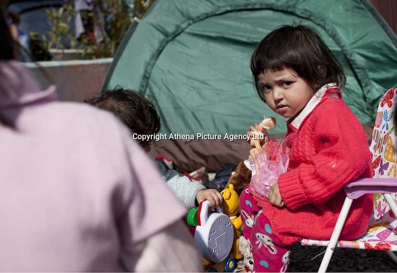 Pictured: A young girl plays with toys Monday 07 March 2016<br /> Re: Migrants have been gathering at the port of Piraeus, near Athens, Greece.