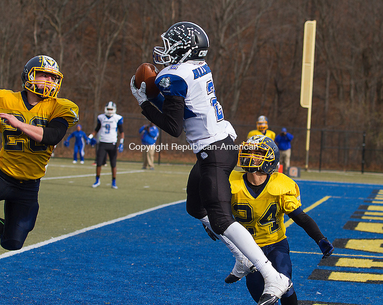 WATERURY, CT - 26 NOVEMBER 2015 -112615JW08.jpg -- Kennedy #20 Jacob Colon and #24 Anthony Delvalle watch as Crosby #2 Eli Mbaya leaps for a pass in the endzone during the Thanksgiving Day 2015 Brass Division and City Championship game at Ray Snyder Sr. Field Thursday morning. Crosby won 18-15.  Jonathan Wilcox Republican-American
