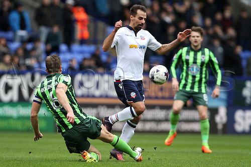 March 4th 2017,  Macron Stadium, Bolton, England;  Skybet league 1 football, Bolton Wanderers versus AFC Wimbledon;  Filipe Morais of Bolton Wanderers is tackled by Paul Robinson of AFC Wimbledon