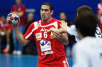 05 APR 2012 - LONDON, GBR - Tunisia's Issam Tej (TUN) (left) passes during the men's 2012 London Cup match against South Korea at the National Sports Centre in Crystal Palace, Great Britain  (PHOTO (C) 2012 NIGEL FARROW)