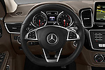 Car pictures of steering wheel view of a 2018 Mercedes Benz GLE AMG-43 5 Door SUV Steering Wheel