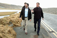 Pictured L-R: Pembrokeshire MP Stephen Crabb and Prime Minister David Cameron walking by the storm damaged coastal road in Newgale, Pembrokeshire. Wednesday 19 February 2014<br />