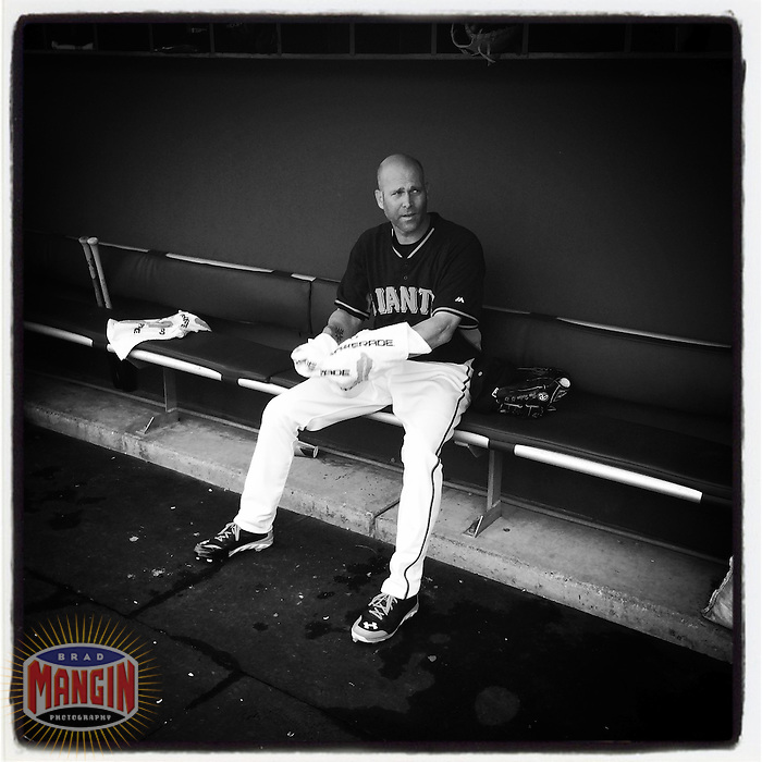 SCOTTSDALE, AZ - MARCH 6: Instagram of Tim Hudson of the San Francisco Giants getting ready in the dugout before a spring training game at Scottsdale Stadium on March 6, 2014 in Scottsdale, Arizona. Photo by Brad Mangin
