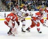 Kieran Millan (BU - 31), Patrick Brown (BC - 23), David Warsofsky (BU - 5) - The Boston College Eagles defeated the Boston University Terriers 3-2 (OT) in their Beanpot opener on Monday, February 7, 2011, at TD Garden in Boston, Massachusetts.