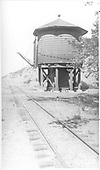 Trackside view of Rio Grande water tank at MP 380.93.<br /> D&amp;RGW  Rio Grande, NM  Taken by Rogers, Donald E. A. - 5/24/1939
