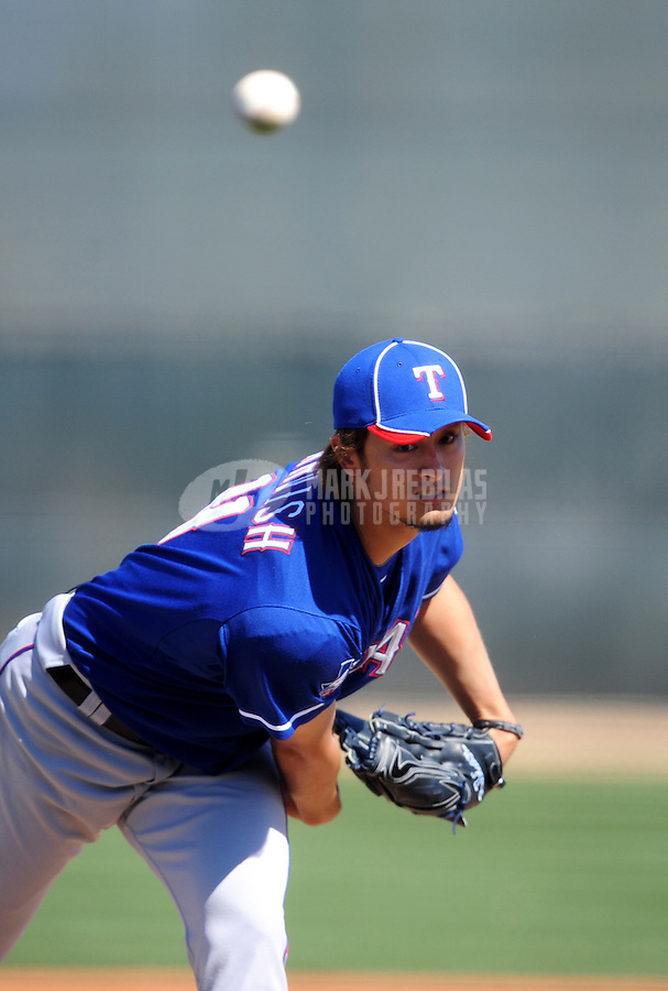 Mar. 2, 2012; Surprise, AZ, USA; Texas Rangers pitcher Yu Darvish pitches during an intrasquad game on the practice fields at Surprise Stadium.  Mandatory Credit: Mark J. Rebilas-.