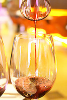 Chakana wine being poured from a decanter to a wine tasting glass. The Restaurant Red at the Hotel Madero Sofitel in Puerto Madero, Buenos Aires Argentina, South America