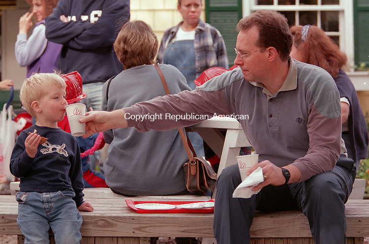 CHESHIRE, CT 10/17/98 --1017JH05.tif--Greg Arthaud of Cheshire offers his son Paul, 2, some cider during the 2nd annual Kidfest at the Hickory Hill Orchards in Cheshire. The event featured hay rides, face painting, pony rides, and a petting zoo. JOHN HARVEY staff photo STANDALONE PHOTO.