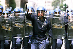PIC BY HEATHCLIFF O'MALLEY.police advance during g8 riots in genova.