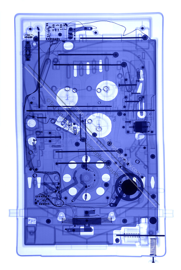 An X-ray of a pinball machine.  The x-ray show teh electronics and  motors that are inside a pinball macnine.