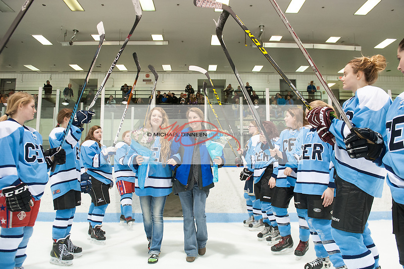 Chugiak Eagle River hockey mom Robin Bassett escorts daughter Savannah during the team's Senior Night ceremony at Ben Boeke Arena Monday, January 25th, 2016.  Photo for the Star by Michael Dinneen