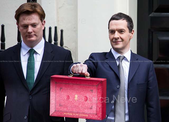 (From R to L) George Osborne &amp; Daniel Alexander (Liberal Democrat party, Chief Secretary to the Treasury).<br /> <br /> London, 18/03/2015. UK Chancellor of the Exchequer, George Osborne (followed by his team) shows the &quot;red box&quot; (Budget Box) containing the Budget for the fiscal year 2015.