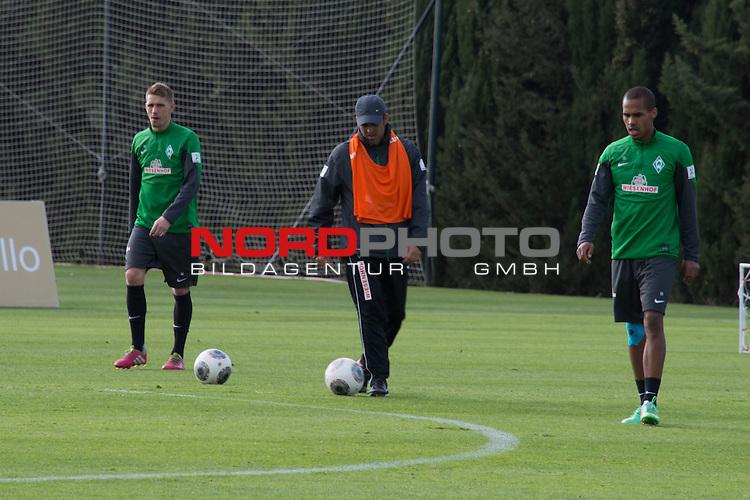Trainingsgel&auml;nde, Jerez, ESP, 1.FBL, Trainingslager Werder Bremen 2014,  14.01.2014, <br /> <br /> Robin Dutt (Trainer Werder Bremen)  mischte am Dienstag nachmittag beim Training kr&auml;ftig mit<br /> <br /> li. Nils Petersen (Bremen #24) <br /> re Theodor Gebre Selassie (Bremen #23)<br /> <br /> <br /> <br /> Foto &copy; nordphoto/ Kokenge