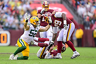 Landover, MD - September 23, 2018: Green Bay Packers linebacker Clay Matthews (52) is called with a costly roughing the passer penalty on Washington Redskins quarterback Alex Smith (11) during game between the Green Bay Packers and the Washington Redskins at FedEx Field in Landover, MD. The Redskins get the win 31-17 over the visiting Packers. (Photo by Phillip Peters/Media Images International)