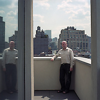 Nico Rensch photographed on a balcony in front of one of the many stunning views of the New York skyline that may be seen from his city centre apartment