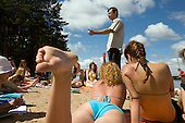 Pro-Putin Nashi youths listen to a lecture on economics on a beach at a summer camp on Lake Seliger in Russia. The yearly camp, organised by the nationalistic group, trains youth in political activism.