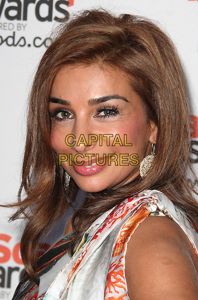 SHOBNA GULATI .At the Inside Soap Awards 2010 held at Shaka Zulu, Camden, London, England, September 27th 2010..portrait headshot white orange print side make-up .CAP/JIL.©Jill Mayhew/Capital Pictures