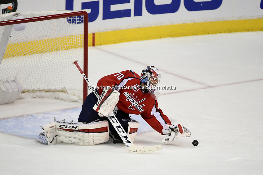 April 23, 2015 - Washington D.C., U.S. -  Washington Capitals goalie Braden Holtby (70) stops the puck during game 5 of the  NHL Eastern Conference Quarter finals between the New York Islanders and the Washington Capitals held at the Verizon Center in Washington DC.