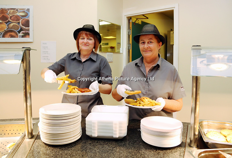 Pictured L-R: Lotto winners colleagues Andrea Davies and Clare Birchall at work at Neath Port Talbot hospital. Wednesday 08 November 2017<br />Re: Presentation of hospital catering syndicate win £25m in Euromillions Jackpot at Hensol Castle, south Wales, UK. Julie Saunders, 56, Doreen Thompson, 56, Louise Ward, 37, Jean Cairns, 73, SIan Jones, 54 and Julie Amphlett, 50 all work as catering staff for Neath Port Talbot Hospital in south Wales.