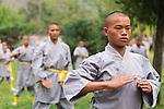 Students of Shaolin martial arts school practicing Qi Gong outside at the opening ceremony of Zhengzhou International Wushu Fetival in DengFeng, Henan, China 2014