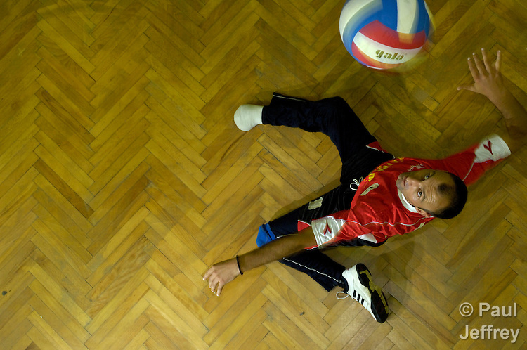 A landmine survivor, missing his right foot, serves the vall in a volleyball game in Banja Luka, Bosnia and Herzegovina. The game is organized by the Landmine Survivors Network.
