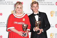 Daisy May and Charlie Cooper in the winners room for the BAFTA TV Awards 2018 at the Royal Festival Hall, London, UK. <br /> 13 May  2018<br /> Picture: Steve Vas/Featureflash/SilverHub 0208 004 5359 sales@silverhubmedia.com