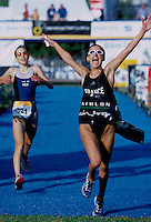 09 NOV 2002 - CANCUN, MEX - Marion Lorblanchet (FRA) takes the Junior Womens title just ahead of Wendy de Boer (NED) at the World Triathlon Championships (PHOTO (CO ) NIGEL FARROW)