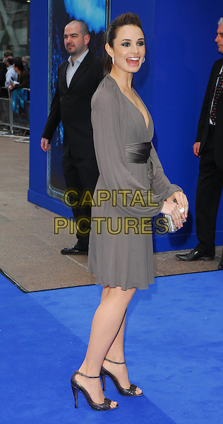 "MIA MAESTRO.At the UK Film Premiere of ""Poseidon"", .Empire Leicester Square, London, .May 28th 2006..full length grey dress wrap waist sash ankle strap shoes.Ref: CAN.www.capitalpictures.com.sales@capitalpictures.com.©Can Nguyen/Capital Pictures"