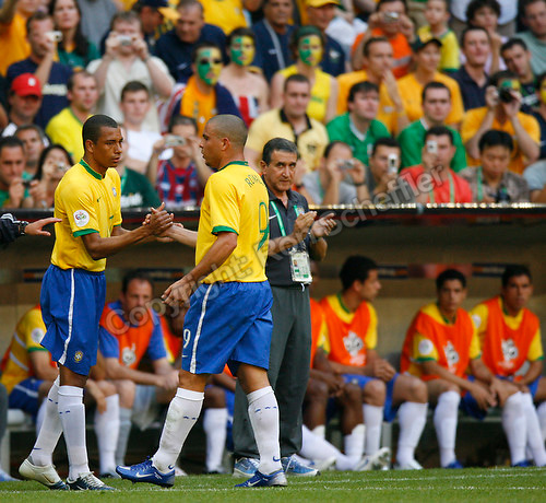 Jun 18, 2006; Munich, GERMANY; Brazil forward (9) Ronaldo shakes hands with midfielder (17) Gilberto Silva as coach Alberto Carlos Parreira looks on. Ronaldo exited the match against Australia in the 72nd minute, in first round Group F action of the 2006 FIFA World Cup at FIFA World Cup Stadium Munich. Brazil defeated Australia 2-0. Mandatory Credit: Ron Scheffler-US PRESSWIRE Copyright © Ron Scheffler.