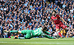 Ederson of Manchester City makes a save from Mohamed Salah of Liverpool during the premier league match at the Etihad Stadium, Manchester. Picture date 9th September 2017. Picture credit should read: David Klein/Sportimage
