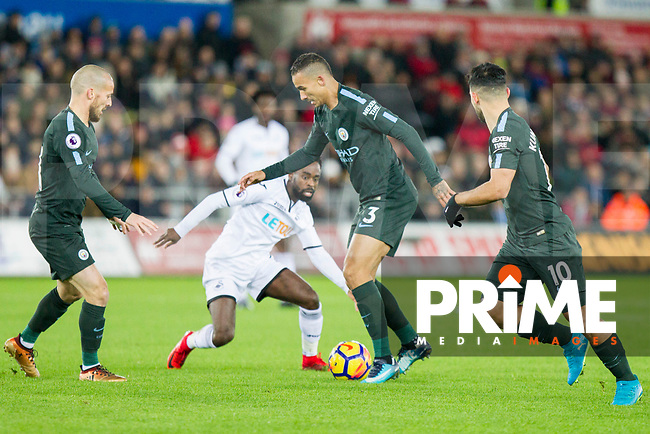 Danilo of Manchester City under pressure from Nathan Dyer of Swansea City and supported by David Silva and Sergio Aguero during the EPL - Premier League match between Swansea City and Manchester City at the Liberty Stadium, Swansea, Wales on 13 December 2017. Photo by Mark  Hawkins / PRiME Media Images.