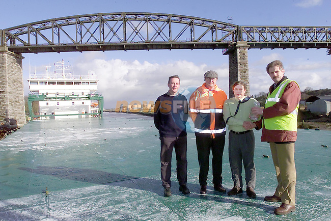 Right Captain Martin Donnelly harbour master presenting a momentum to captain of the arklow Brook Malcom Morton with Tom O'Reilly froma Butterlys and Philip McArdle after the ship discharged the largest ship in Drogheda port...Picture Fran Caffrey Newsfile.