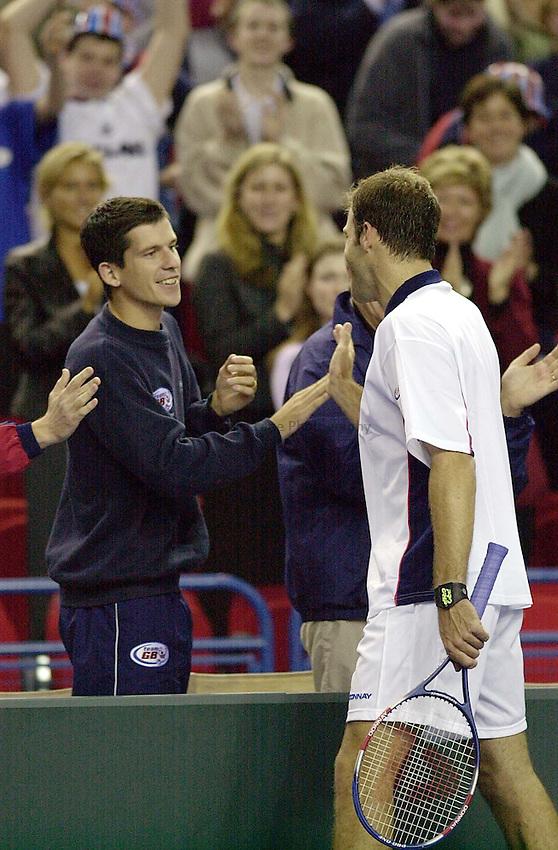 Photo:Ken Brown .6.4.2001 Davis Cup Great Britain v Portugal.Greg Rusedski v Emanuel Couto.Tim Henman congratulates Greg on his victory
