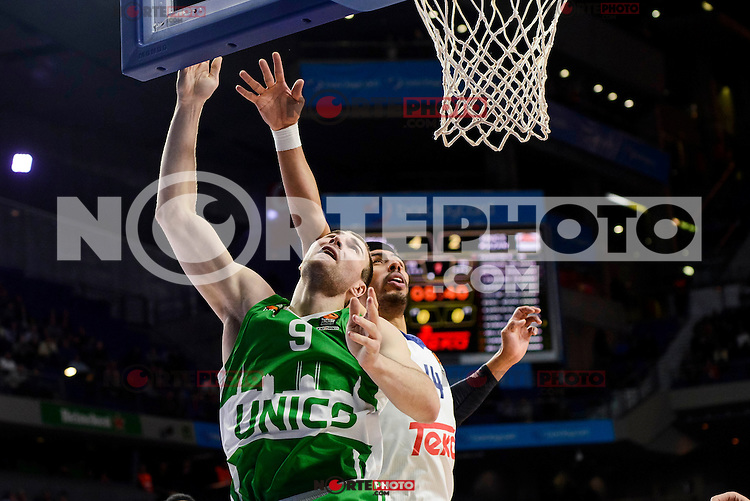 Real Madrid's player Gustavo Ayon and Unics Kazan's player Artsiom Parakhouski during match of Turkish Airlines Euroleague at Barclaycard Center in Madrid. November 24, Spain. 2016. (ALTERPHOTOS/BorjaB.Hojas) //NORTEPHOTO