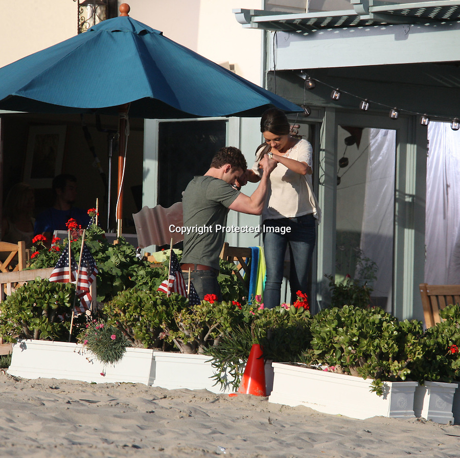 "TUESDAY August 31, 2010...Justin Timberlake picking up Mila Kunis & hugging a little kid..Richard Jenkins took off his pants wearing just his underwear next to a big dog while filming a scene for the movie ""Friends with Benefits"" in Malibu beach. .Jenna Elfman was holding an American Flag & jumping in the air. Justin was running full speed on the beach chasing Mila ..AbilityFilms@yahoo.com.805-427-3519.www.AbilityFilms.com"