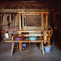 Yarn and looms in a weaving workshop in Teotitlan del Valle near Oaxaca, Mexico.